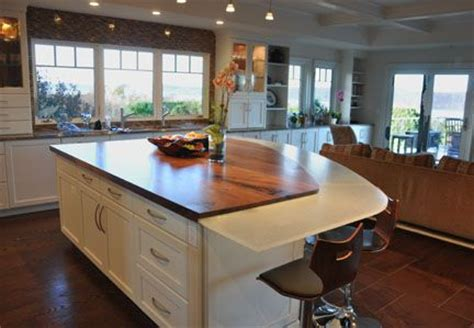 glass top kitchen island sandblasted glass kitchen island top surrounding and lit from a live edge table top in a