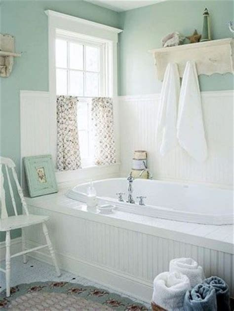 a pretty bathroom in seafoam green and whites perfection