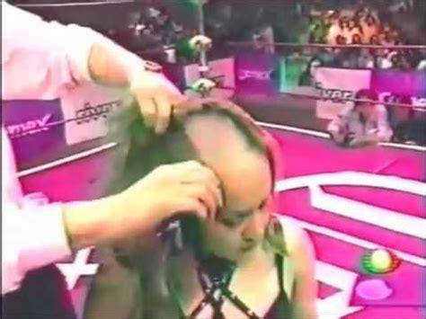 i would like a forced headshave public head shave a forced headshave in wrestling ring