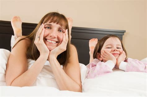 in bed with mom mommy tasking how to find more time to spend with your kids