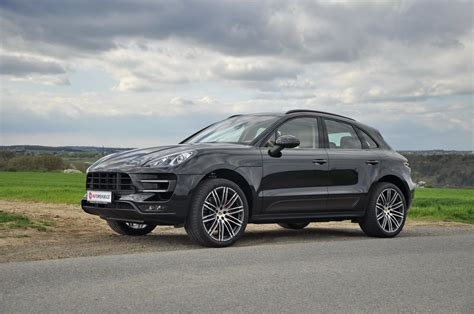 porsche macan all black black turbo with the black exterior package and 21s and