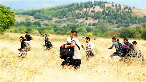 K Fed Running For The Border by Macedonia Refugee Emergency Thousands Run Across Border