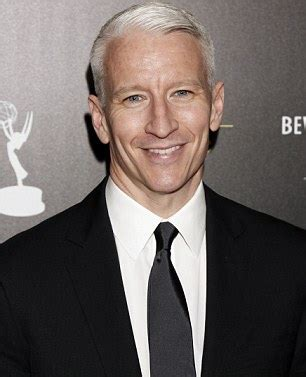 who is the cnn host with white hair anderson cooper comes out as gay the fact is i m gay