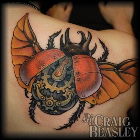 beautiful colored biomechanical bug tattoo on shoulder