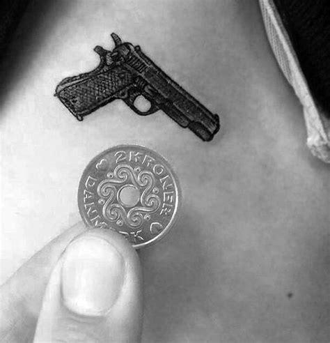small pistol tattoos 60 quarter sized tattoos for mini design ideas
