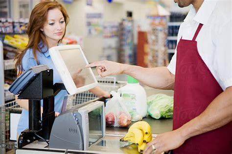 supermarket cashier ringing up purchase by locke