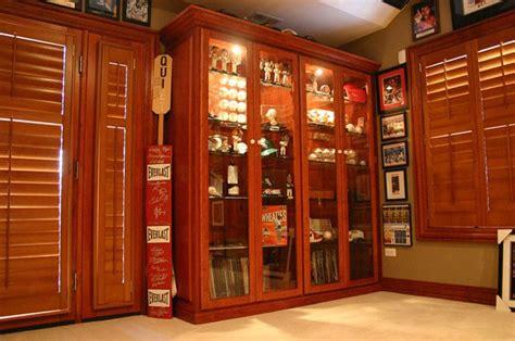 unique sports memorabilia display cabinet basement