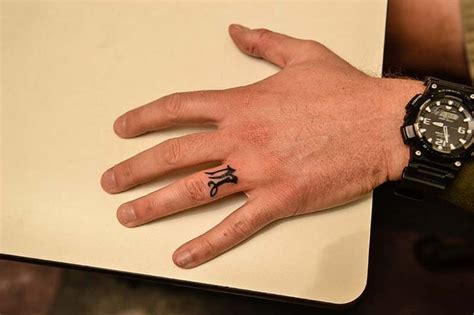 tattoo on willies finger ring and finger tattoos ring and finger tattoos pinterest