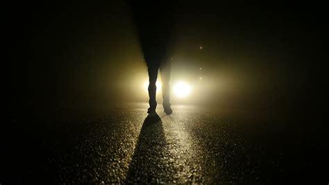 light for walking at night mystery person walking in dark night light beams