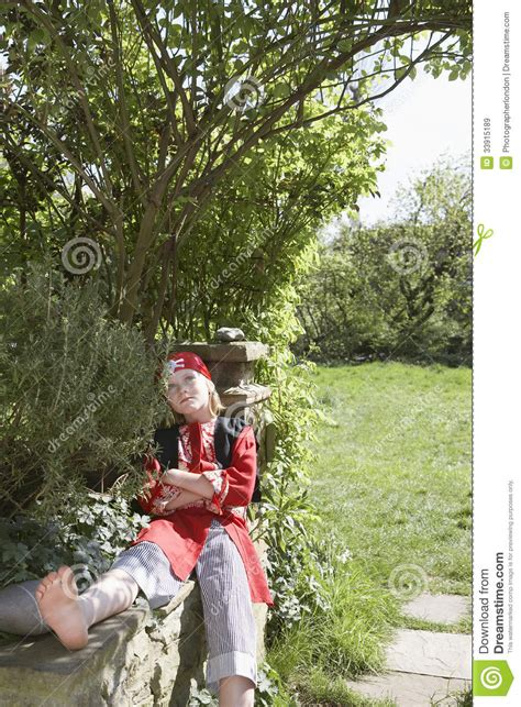 costume with arms boy in pirate costume with arms crossed in garden royalty free stock images image