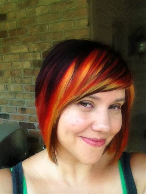 hairstyles with color panels dark hair with red orange and yellow panels hair