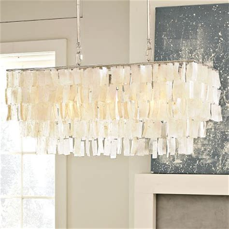 Rectangular Capiz Chandelier Well Nested Interiors Sleek Sultry And Sophisticated A Lounge Space For Grown Ups
