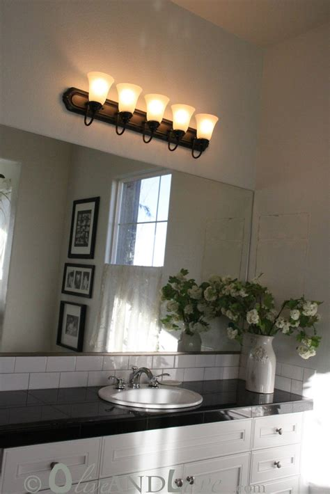 spray painting bathroom light fixture oliveandlove