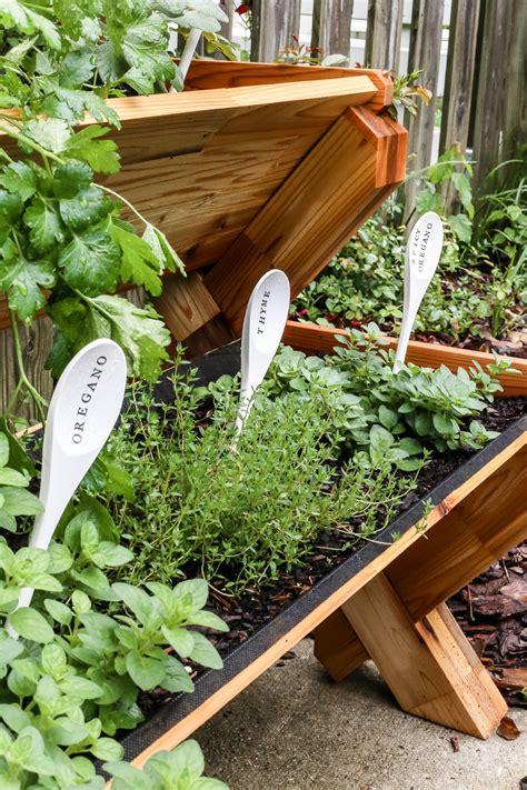 diy stacked herb garden hip2save diy wooden spoon garden markers wooden spoon and herbs