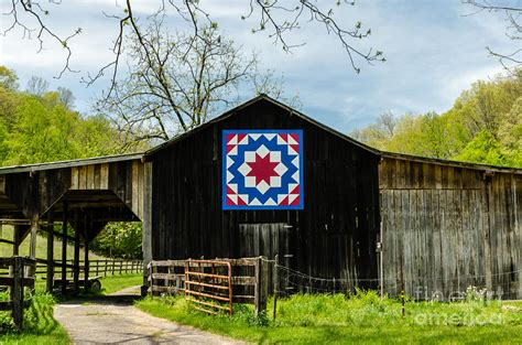 quilt pattern on barns in kentucky kentucky barn quilt carpenters wheel photograph by mary