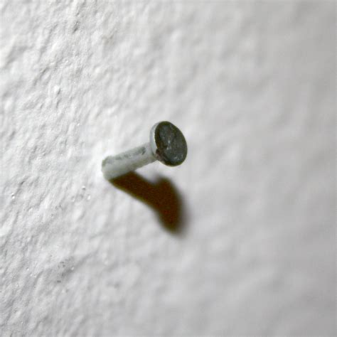 wall nails small nail sticking out of wall picture free