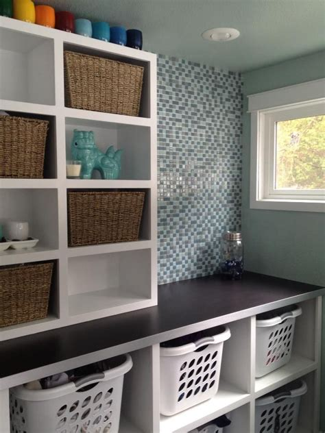 laundry baskets and open shelves basement laundry rooms