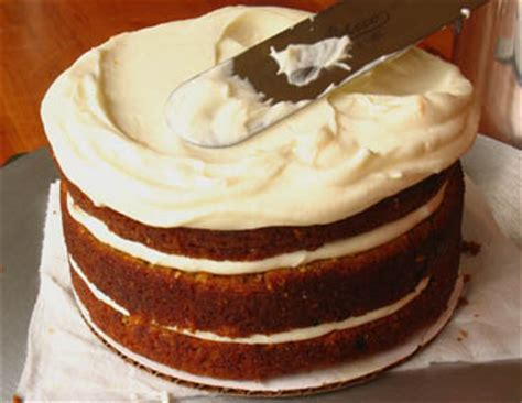le pour cing the ultimate carrot cake with cheese frosting how to assemble the cake zoe bakes