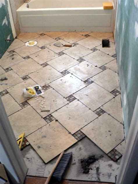 how to lay floor tile in a bathroom our big bathroom reveal snugasabugbaby