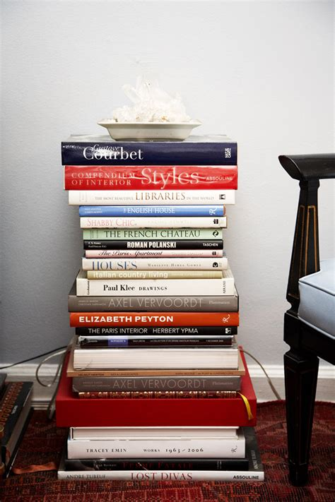decorating with stacks of books popsugar home