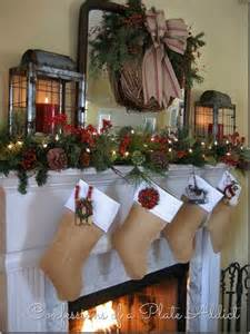 Christmas mantel complete with lanterns for a rustic christmas