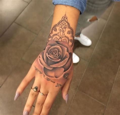 rose on hand tattoo tattoos and piercings