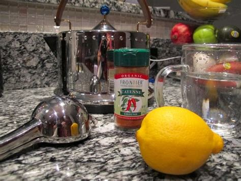 Cayenne Water Detox by Lemon Water Lemon And Cayenne Peppers On