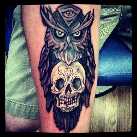 owl with skull tattooed by artist paulie thrasher at blue