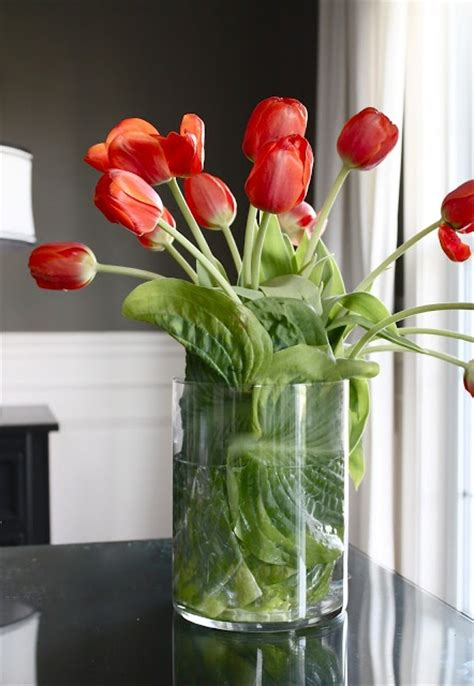 Putting Tulips In A Vase by Great Idea Use Hosta Leaves To Wrap Your Flowers When