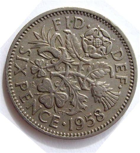 aa coin display six pence coin