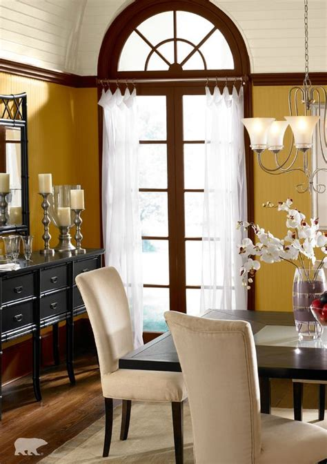 behr paint in romanesque gold and baronial brown is sure to make the wall color to pair