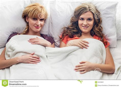 two girls in bed portrait of two girls at bed stock photo image 62229821