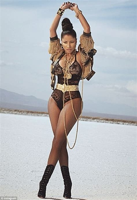 nicki minaj shows off figure in new music video lookin a