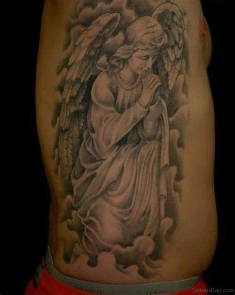 kneeling angel tattoo 58 fancy tattoos for rib