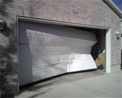 Open Garage Door With Broken by Residential Repair