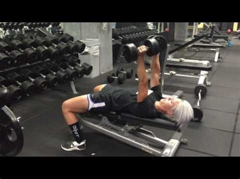 flat bench press with dumbbells dumbbell bench press exercise com