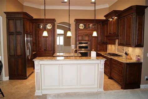 espresso kitchen cabinets with white island photos