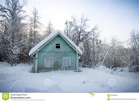 wooden russian house in winter covered with snow stock wooden house in snow covered russian wood stock image
