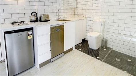 in the fascist bathroom france now allows toilets in kitchens and living rooms