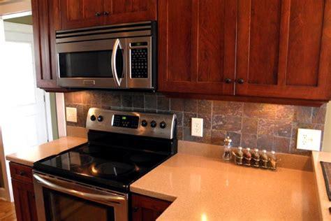 cherry cabinets with custom slate backsplash