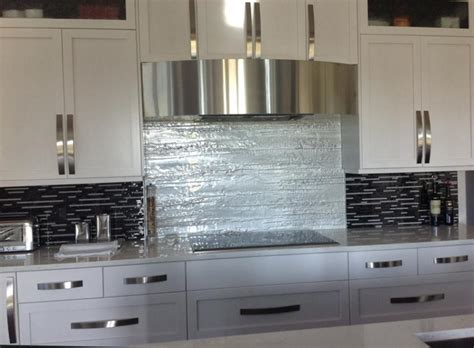 silver gold and taupe metallic glass tile kitchen