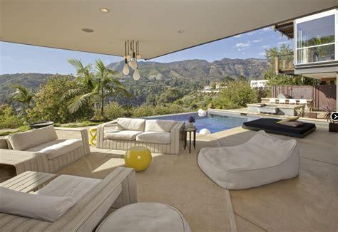building a home blog ashton kutcher sells glassy hollywood bachelor pad