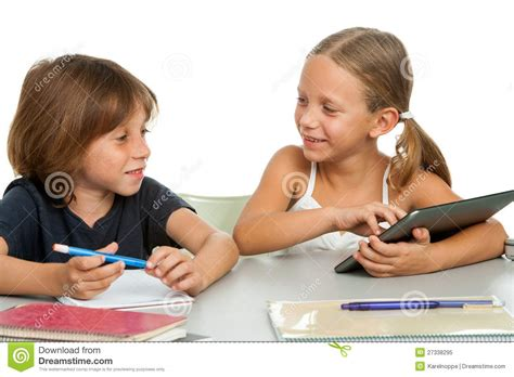 kids desk for two two kids discussing homework at desk royalty free stock