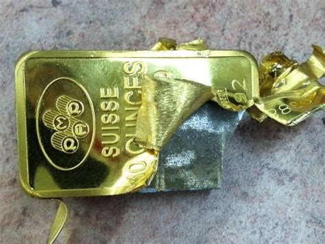 10 ounce silver bar worth tungsten filled 10 oz gold bar found in the middle of