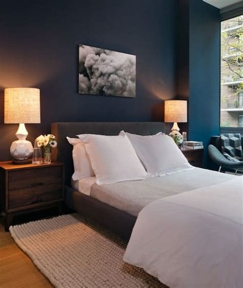 haus interior blue bedroom with peacock blue teal walls paint color charcoal gray
