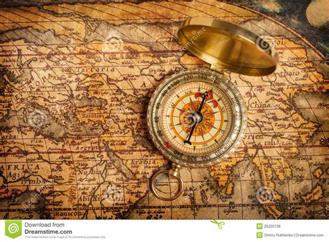 old vintage golden compass on ancient map royalty free