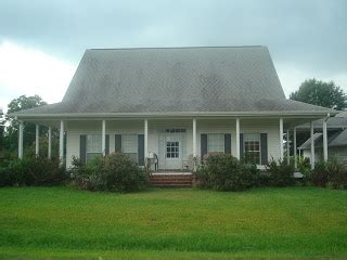 acadian style see lafayette homes acadian style w wrap around porch