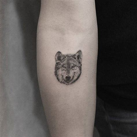 small wolf head tattoo single needle wolf on the inner forearm