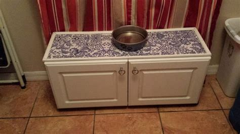 repurposed kitchen cabinets hometalk repurposed laminate cabinet turned big puppy