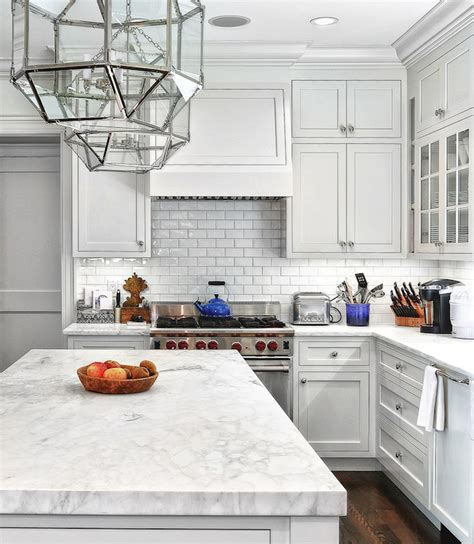 Superb Beveled Tiles Kitchen #2: Classic-kitchen-design-with-marble-countertop-and-subway-tiles-stainless-steel-stove.jpg